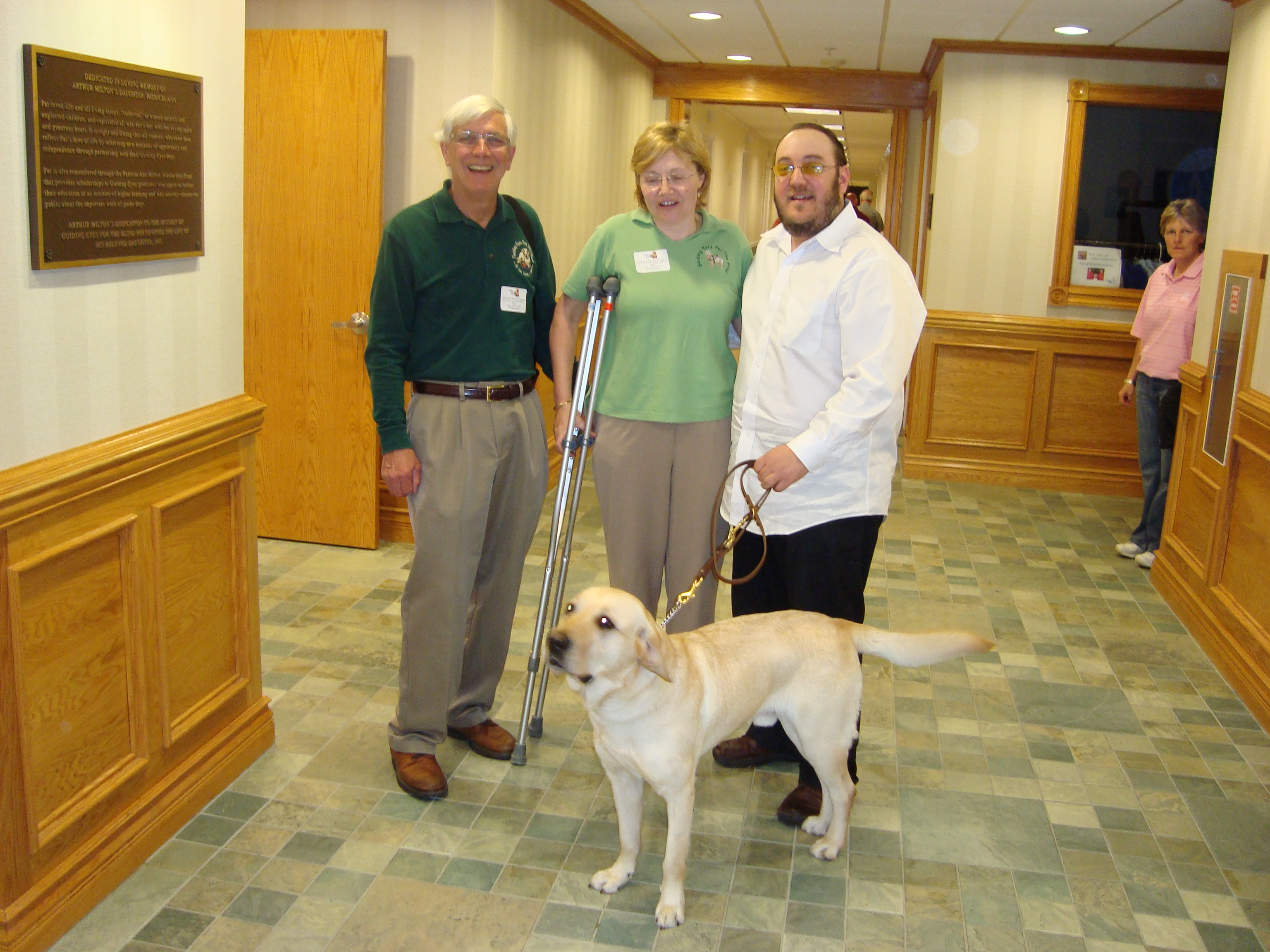 Nash, Puppy Raisers Lorraine and Richard, and me