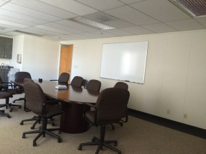 We have access to a shared conference room right down the hall. It has a large oval table with room for 10 and additional chairs. It has AV equipment and a small kitchenette.