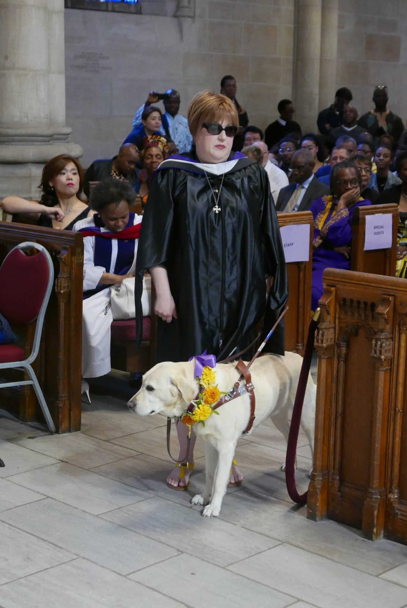 Holly & guide dog, Frances, prepare to graduate from the seminary.
