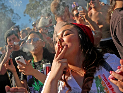 Young Americans smoking pot, totally oblivious to their loss of their right to keep and bear arms