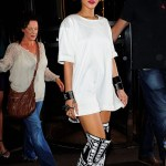Rihanna works the white tee shirt as a dress with over the knee boots.