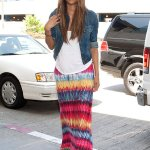 Ciara goes boho chic with a white tee, colorful maxi skirt and denim jacket.