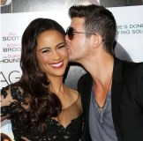 Paula Patton (L) and recording artist Robin Thicke attend the premiere of Fox Searchlight Pictures' 'Baggage Claim'