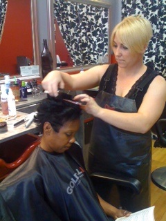 Tina working on a client's hair