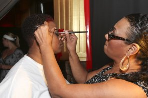 Tiffanie Drummer getting makeup applied by Tracey Brown at Kiss the Curves