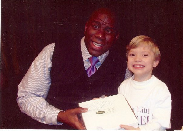 Sharon, a Bliss customer, delivered a sweet potato pie to NBA legend Magic Johnson at a recent book signing at Norfolk State University. Her grandson, Carson McConnell, holds our pie with Magic in this picture.
