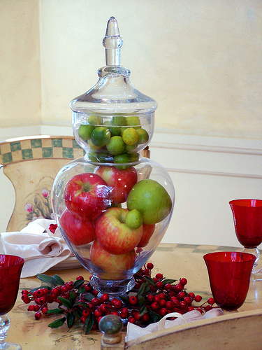 red & green fruit in glass container
