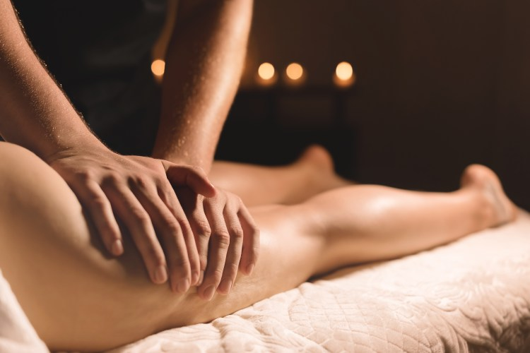 Massage therapist relieving hamstring tension