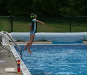 A child jumping into a pool. Summer travel!