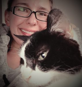 Saying goodbye to Draco. Pictured is a brown haired woman and a black and white cat.