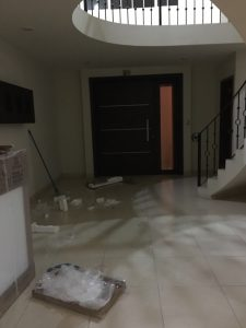 Picture of our entry way, with styrofoam and cardboard all over.