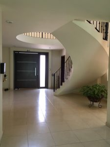 A view of a large entry way and circular staircase. It's our house!