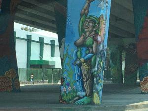 A mural underneath a bridge.