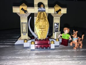 A scooby doo lego set with a mummy, scooby, and Shaggy.