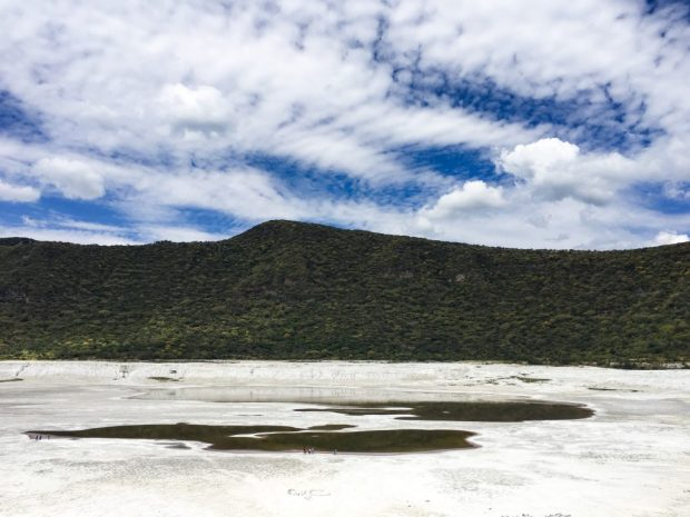Las Siete Luminarias, a lush green mountain, with a white, barren crater. It looks like snow in the crater, but it isn't. It's kind of sandy clay. It is one of the awesome places in Mexico you can visit!