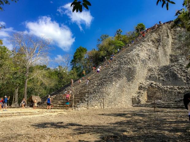 People climbing the pyramid at Coba.
