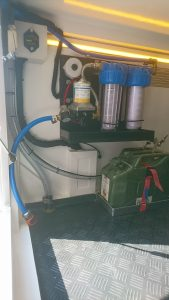 External storage garage showing diesel fuel canister for heater (from our 15-foot Bliss Mobil expedition camper unit).
