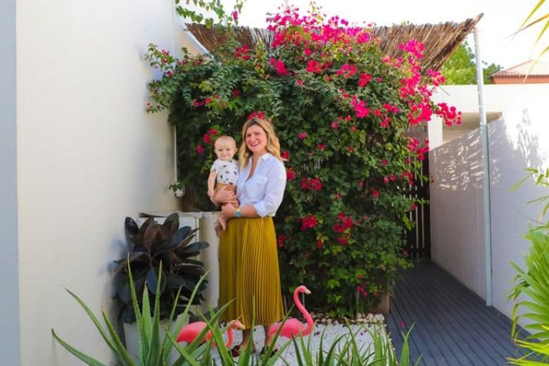 Interior stylist Emilie Jacobs and child in garden