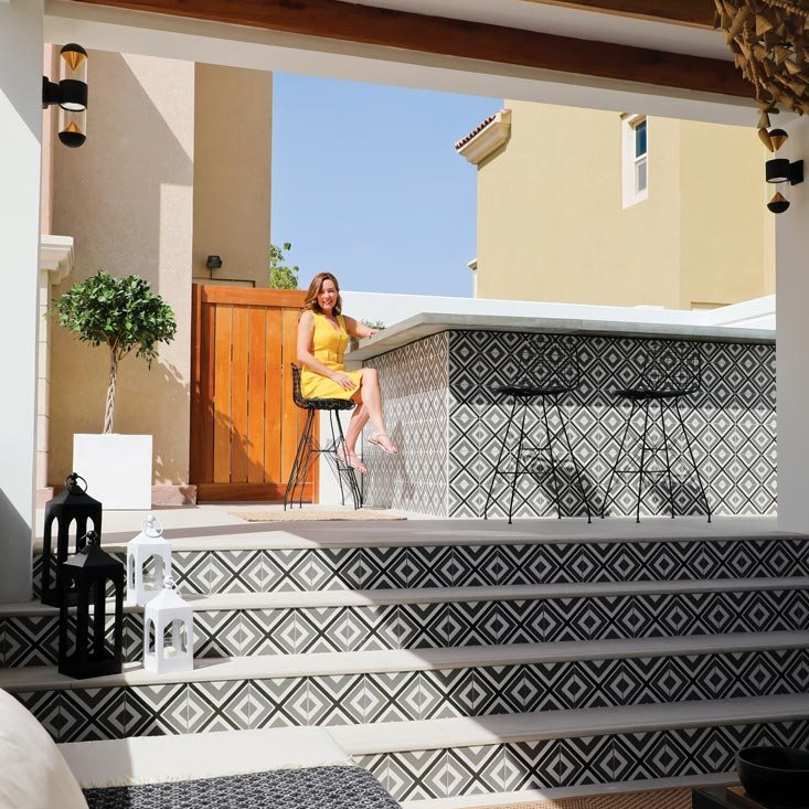 Rhian Clarke black and white tiles garden and pool