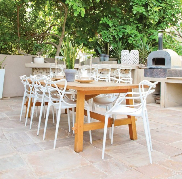 Garden dining area with stone oven