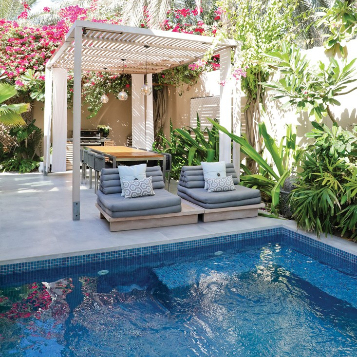 Outdoor pool with shaded dining area