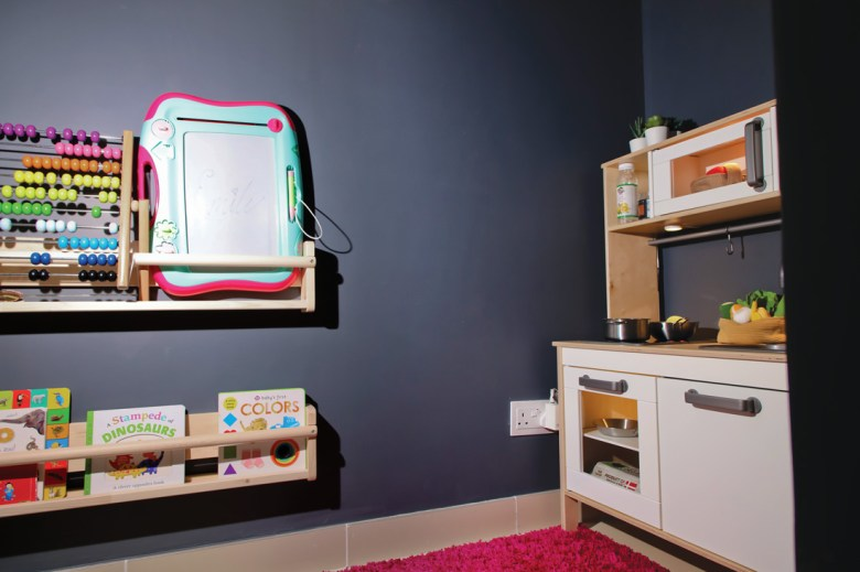 Play area under the stairs with shelf and kitchen