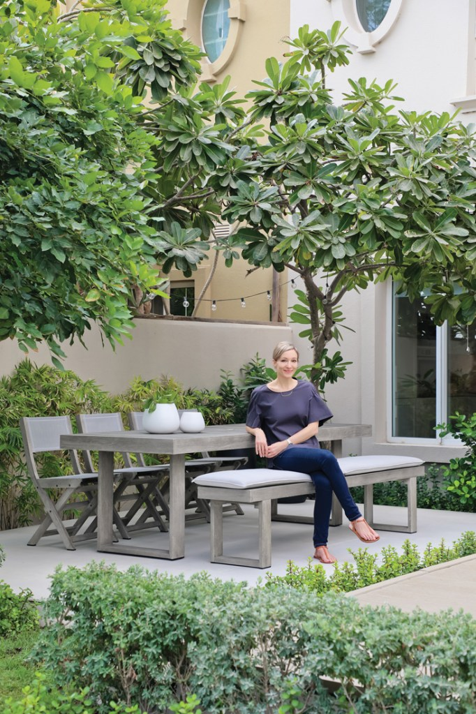 Karen from Design K in her green Dubai garden