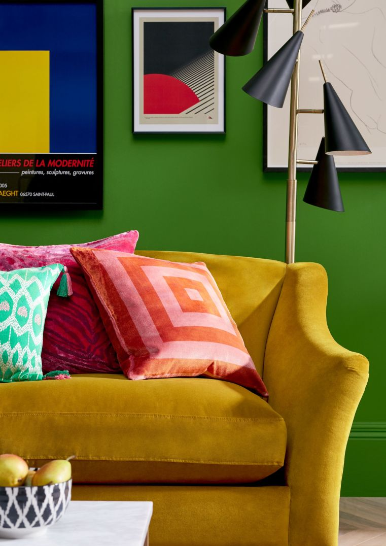 Yellow sofa with green paint on the walls
