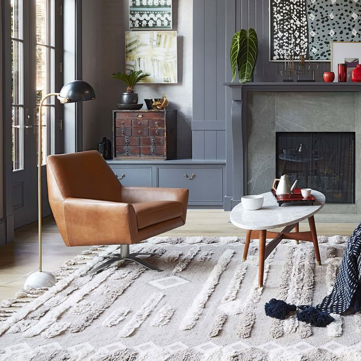 Living room with brown leather chair and cream rug