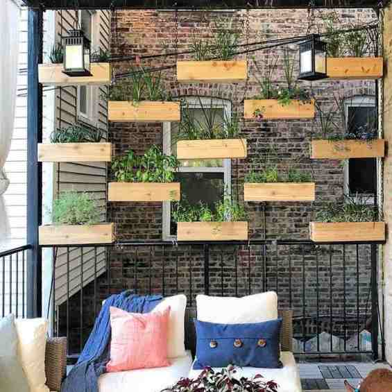 Plant pots hung above railings in a living space