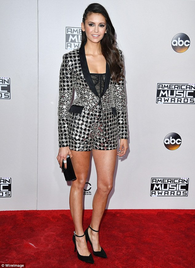 Stunning lady: Nina wowed in a black and silver look that showed off her toned legs