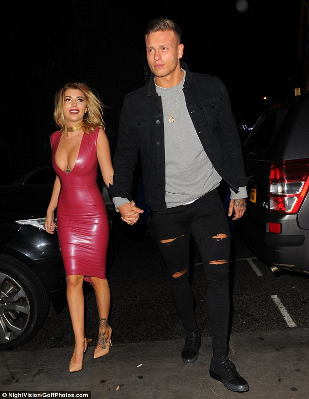 Sizzling: Olivia, 22, smouldered in a skintight pink Latex dress with a plunging neckline
