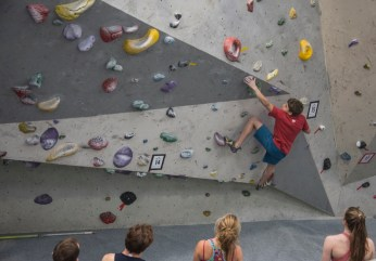 Xavier climbing with girl in foreground