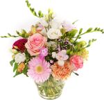 Glazen vaas met pastel bloemen bestellen of bezorgen
