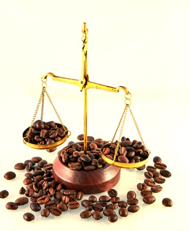 Coffee theme with brass scales still life on white background.