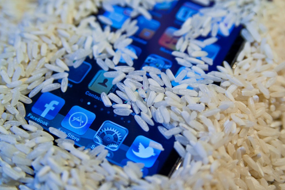 white rice drying phone while camping