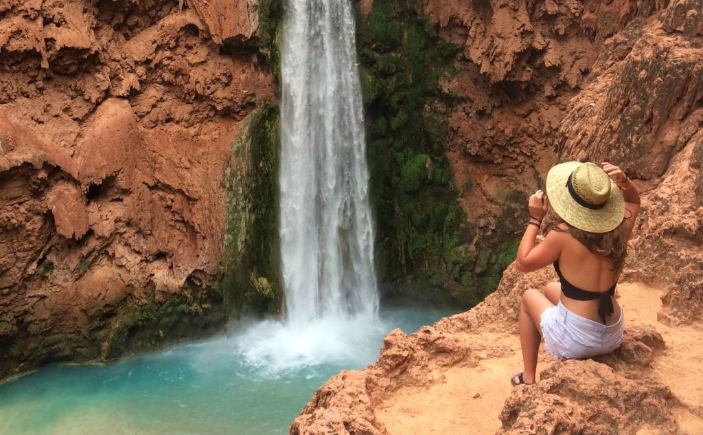 camper photographing havasu falls on camping trip