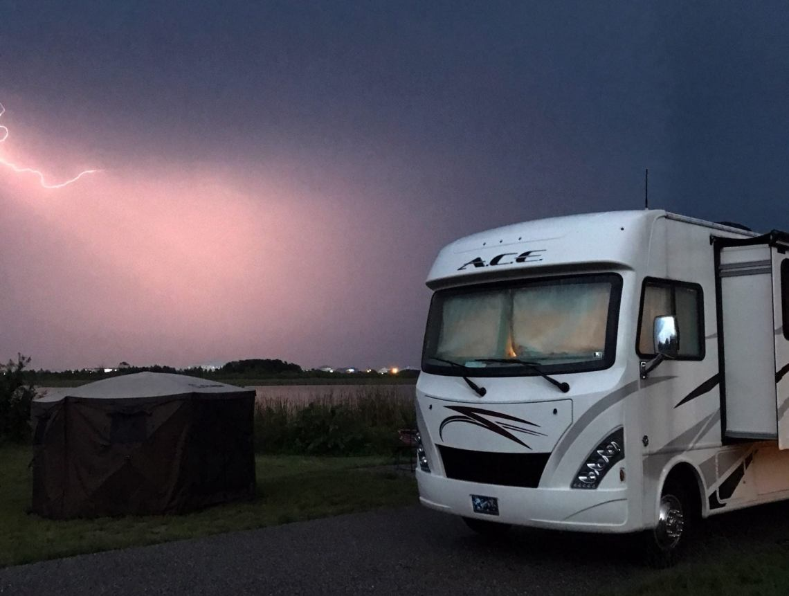 large ACE RV in a lighting storm