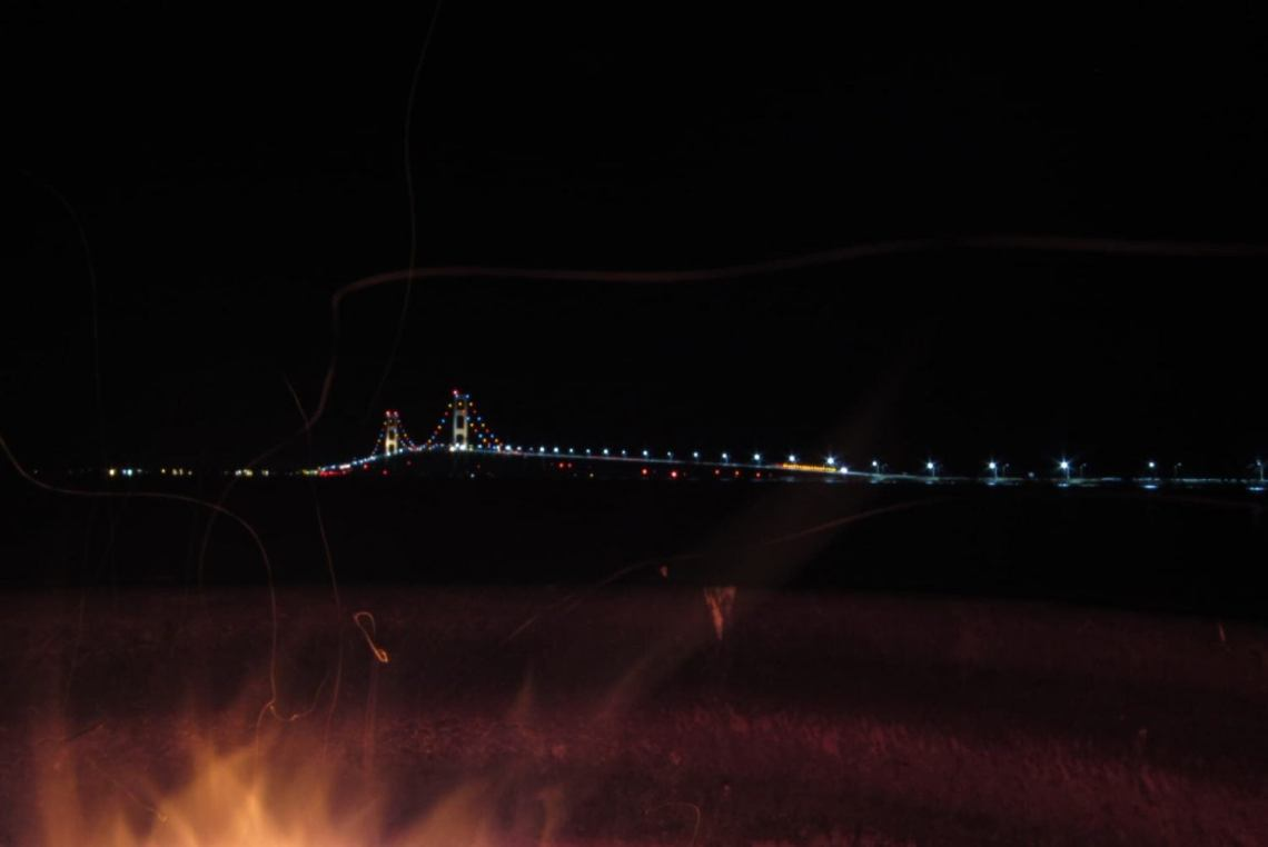 night view of the Mackinac Bridge over Lake Michigan from campsite in Straits State Park