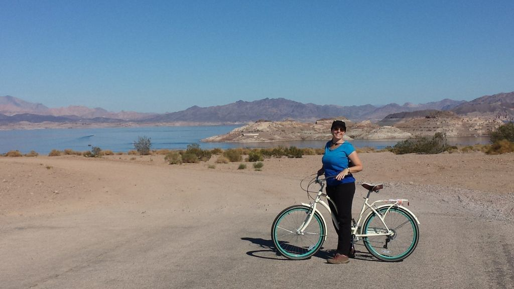 a biker poses on boulder beach at lake mead in nevada