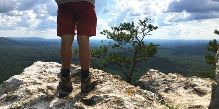 hiker stands atop elevated portion of the pinhoti trail