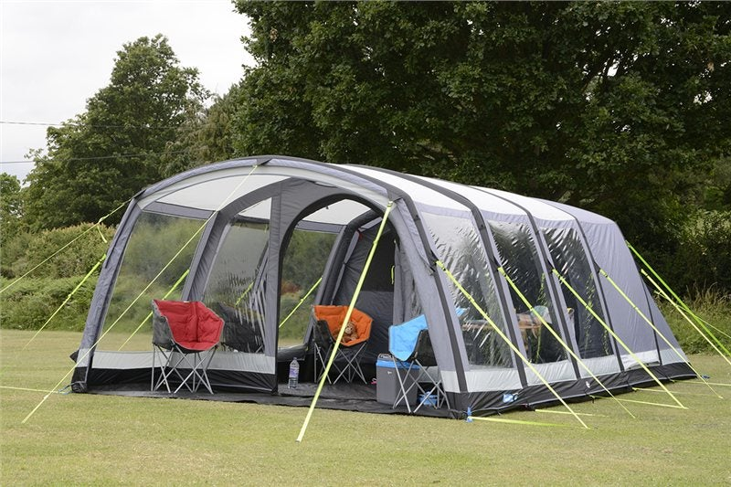 kampa hayling tent with many windows and rooms set up in a field on a cloudy day
