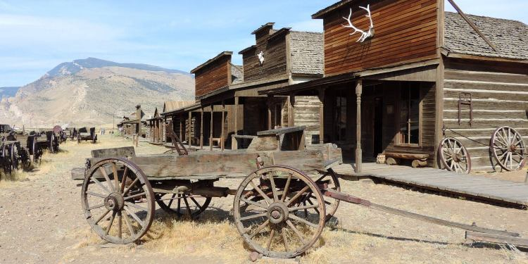 Wagon in front of old and rustic building in Cody, Wyoming