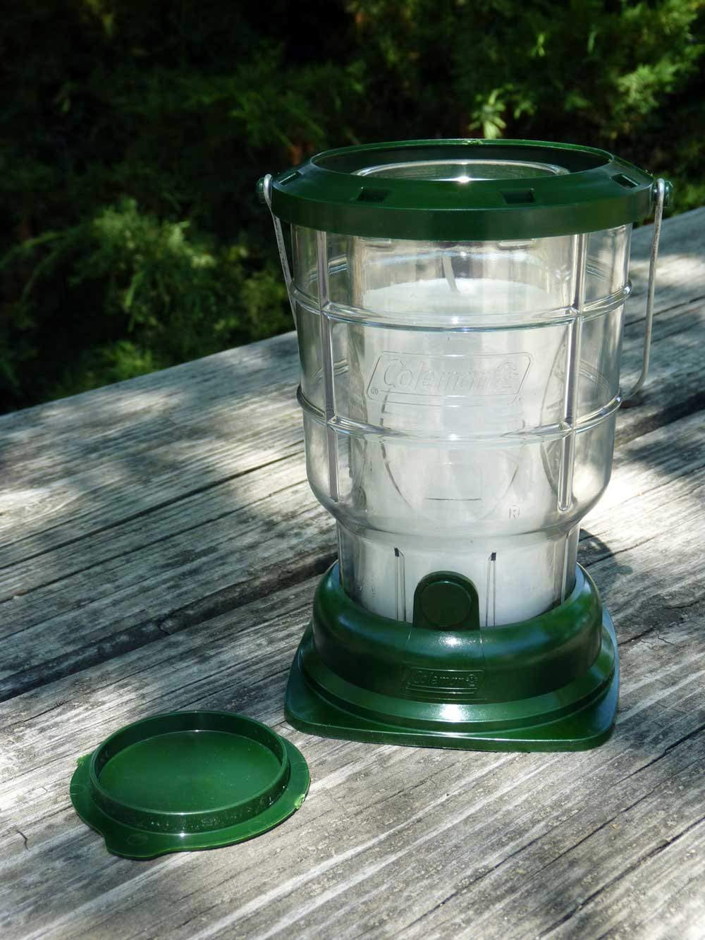 Citronella candle placed on picnic table