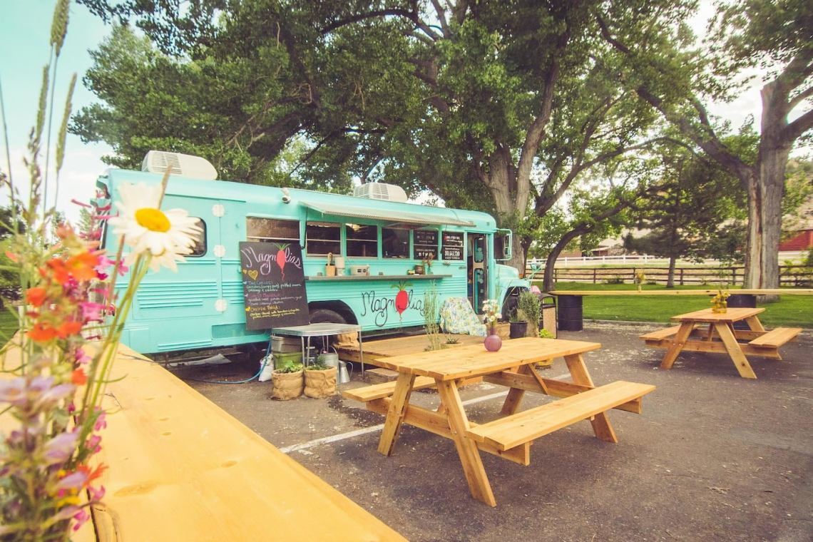 Magnolia's teal bus converted into a food truck.