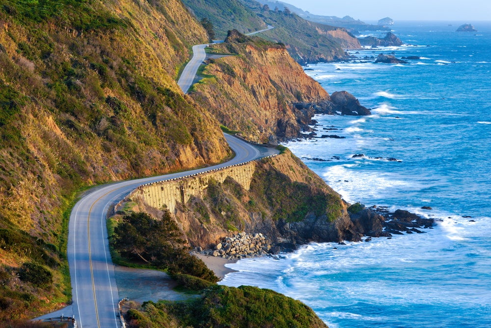 Wide angle view of the Pacific Coast Highway with rocky coast