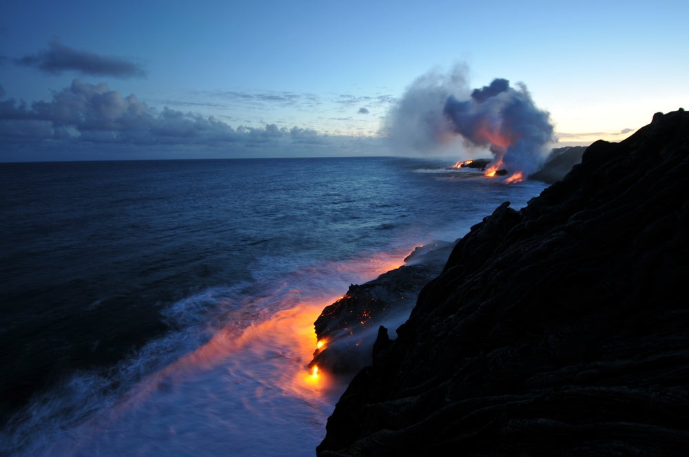 Landscape view of lava hitting ocean