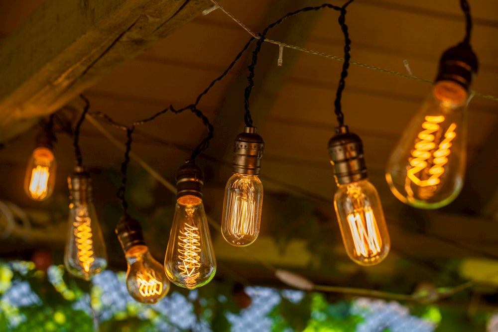 Edison lightbulbs on a string hung from a roof