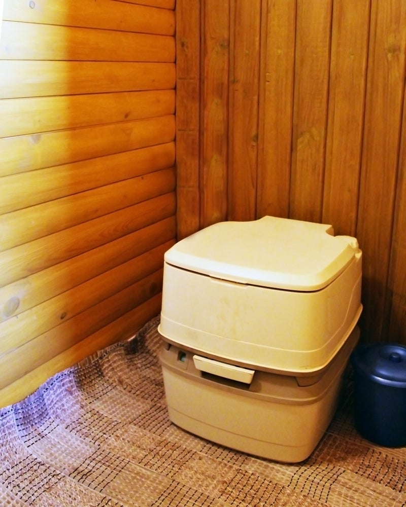 Boxy composting toilet with lower compartment.
