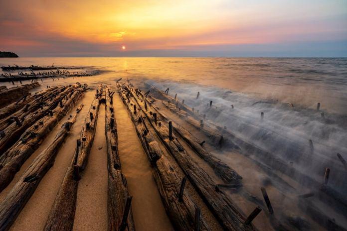 Shipwreck on lake superior during sunset.